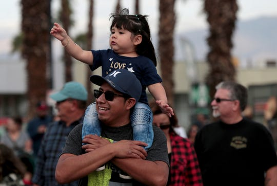 Nicolas Puac of Indio carries his two-year-old daughter, Barbara Puac, on his shoulders at the Indio International Tamale Festival drew a large crowd in Indio, Calif., on December 7, 2019.