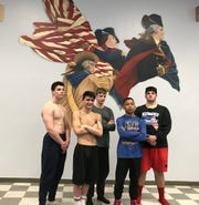 Pace High wrestlers (L to R) Gabe Jacobs, Ethan Billhimer, Atticus Waters, Derrick Lancero and Cameron Goodnow each qualified for the FHSAA state championships last year and aim to take the Patriots far this year.