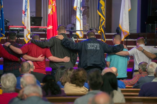 First responders and members of the military come together at Olive Baptist Church in Warrington Saturday, Dec. 7, 2019, during the memorial service for the victims of the shooting at NAS Pensacola.