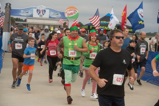Runners make their way around the runway during the 7th Annual Runway Run 5K at Pensacola International Airport Saturday, Dec. 7 2019.