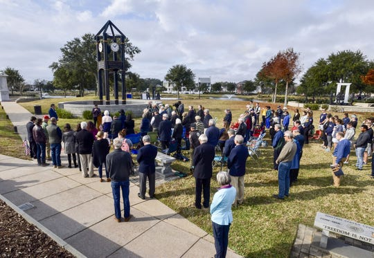 The community gathers Saturday, Dec. 7, 2019, at Veterans Memorial Park in Pensacola for an event on Pearl Harbor Remembrance Day that honors U.S. Naval Academy graduates with ties to the Pensacola area. Joshua Kaleb Watson, 23, a recent graduate of the U.S. Naval Academy, was one of the victims of Friday's shooting at Naval Air Station Pensacola.