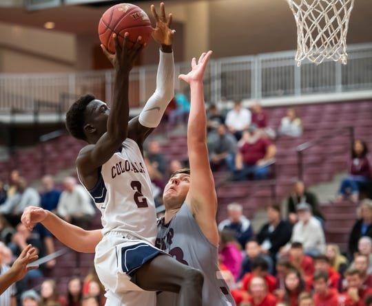 New Oxford's Abdul Janneh goes up for a layup during a semifinal game against Shippensburg in the GWABC Tip-Off Tournament in Gettysburg Friday, Dec. 6, 2019.