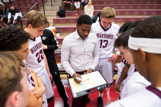 Gettysburg head coach Lawrence Williams draws up a play before the start of the third quarter in a semifinal game against Lancaster Mennonite in the GWABC Tip-Off Tournament in Gettysburg Friday, Dec. 6, 2019. The Warriors won, 63-51.