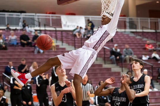 Gettysburg's Quadir Copeland hangs from the rim after dunking the ball during a semifinal game against Lancaster Mennonite in the GWABC Tip-Off Tournament in Gettysburg Friday, Dec. 6, 2019. Copeland lead the team with 22 points and was 2-2 from the line as the Warriors won, 63-51.
