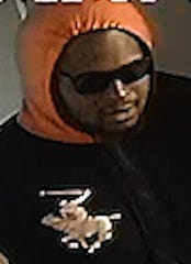 Unidentified man accused of armed robbery of two fast-food restaurants