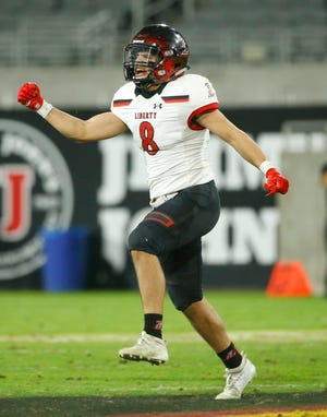 Liberty's Jax Stam (8) celebrates a 4th and 1 stop against Red Mountain during the first half of the 6A State Championship game at Sun Devil Stadium in Tempe, Ariz. on Dec. 6, 2019.