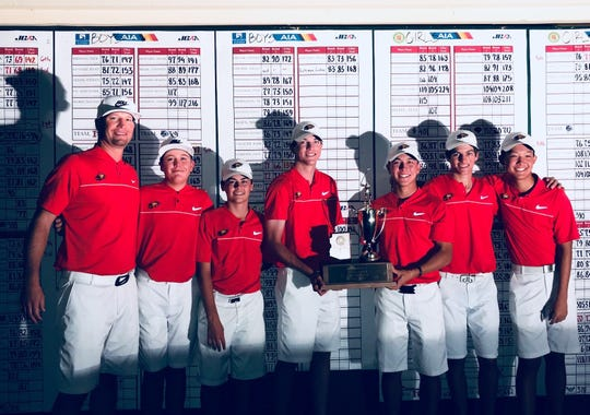 Chaparral boys golf coach Daniel Peterson stands with his team after they win the 2017 Division I state title