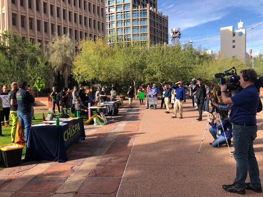 Groups rally outside of Phoenix City Hall as part of the Youth Climate Strike on December 6, 2019.