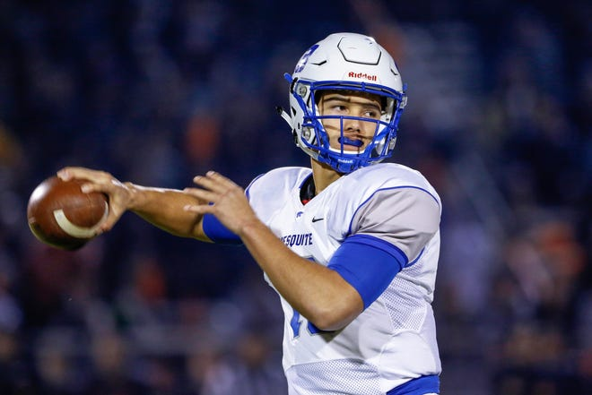Mesquite Quarterback Ty Thompson looks to throw the ball against Desert Edge in the 4A State Championship on Dec. 6, 2019 in Surprise, AZ.