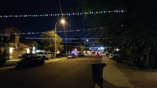 About 22 strands of Christmas lights are hung from house to house along Canary Way.