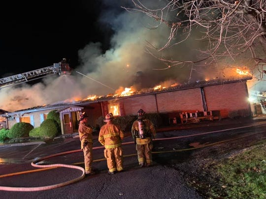 Firefighters work on the scene of a blaze at Ono Family Restaurant late Friday night. taurant
