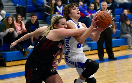 Croswell-Lexington's Lily Connelly fouls as she shoots during their basketball game against Kingston Friday night at CrosLex High School.
