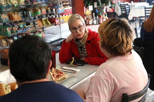 Mayor of Reno Hillary Schieve meets with 14 year old Frankie, right, and his father Franklin at Michael's Deli in midtown Reno on Dec. 6, 2019.