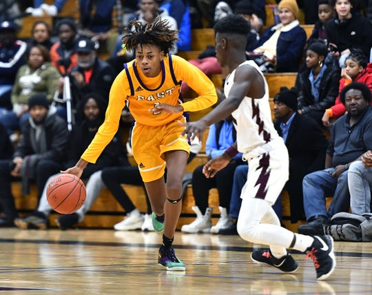 East's Damani Barley, left, is defended by Edison Tech's Edgar Bass IV during a regular season game at Edison Career & Technology High School, Friday, Dec. 6, 2019.