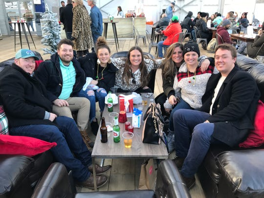 A group of seven relatives gathered to celebrate in The Lodge at ROC Holiday Village on Dec. 7, 2019. A year prior, Carly McCarthy, second from right, had been in a coma with leukemia, and they were rejoicing about her remission.