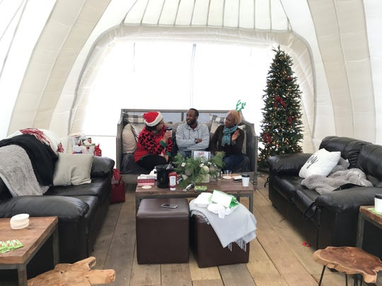 April Hill, Taj Smith and Debora McDell were part of a group enjoying an igloo at ROC Holiday Village on Dec. 7, 2019.