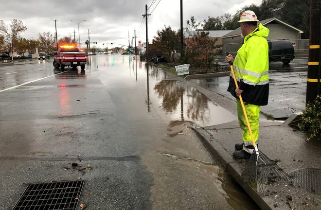 A California Department of Transportation worker keeps storm drains cleared of leaves and debris to reduce flooding that occurred in the 3300 block of South Market Street on Saturday, Dec. 7, 2019, due to heavy rain.
