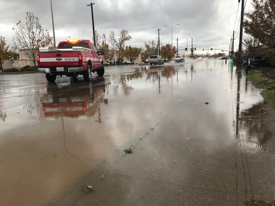 A Redding Fire Department pickup is parked on South Market Street across from the Redding Area Bus Authority offices on Saturday, Dec. 7, 2019. Water was 2 feet high in this area about 1 p.m.