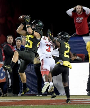 Oregon Ducks safety Brady Breeze (25) intercepts a pass intended for Utah Utes wide receiver Demari Simpkins (3) during the first half of the Pac-12 Conference championship game at Levi's Stadium.