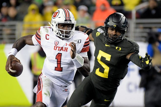 Utah Utes quarterback Tyler Huntley (1) rushes against Oregon Ducks defensive end Kayvon Thibodeaux (5) during the first half of the Pac-12 Conference championship game at Levi's Stadium.