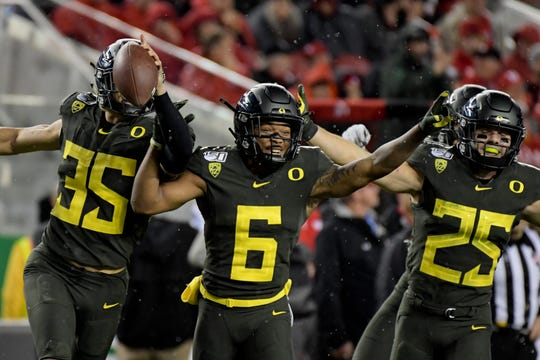 Oregon Ducks linebacker Troy Dye (35) and Oregon cornerback Deommodore Lenoir (6) and Oregon safety Brady Breeze (25) react during the second half of the Pac-12 Conference championship game against the Utah Utes at Levi's Stadium.