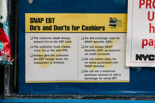A sign alerting customers about SNAP food stamps benefits is displayed in a Brooklyn grocery store on December 5, 2019 in New York City. Earlier this week the Trump Administration announced stricter requirements for food stamps benefits that would cut support for nearly 700,000 poor Americans.