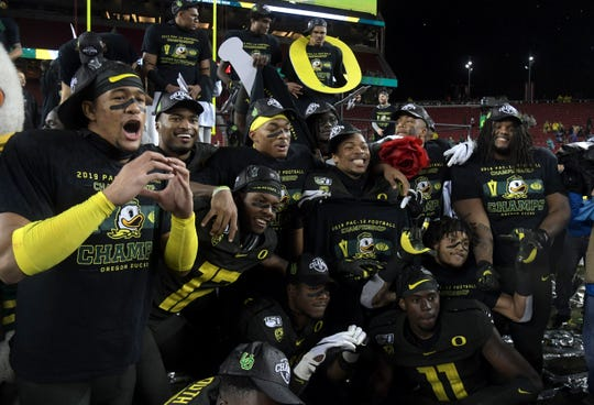 Dec 6, 2019; Santa Clara, CA, USA; Oregon Ducks players pose after the Pac-12 Conference championship game against the Utah Utes at Levi's Stadium. Oregon defeteed Utah 37-15. Mandatory Credit: Kirby Lee-USA TODAY Sports
