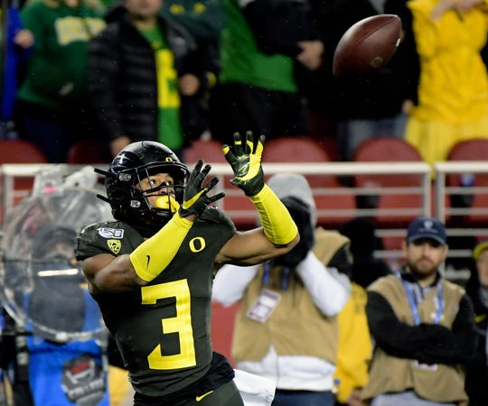 Oregon Ducks wide receiver Johnny Johnson III (3) catches a pass and rushes for a touchdown during the first half of the Pac-12 Conference championship game against the Utah Utes at Levi's Stadium.