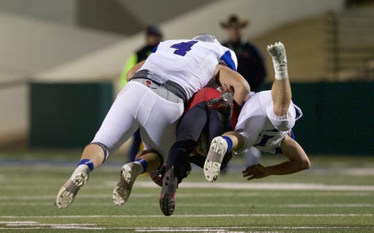 Players on the Richland Springs defense tackle a Strawn player during the Class 1A Division II state semifinal game in Abilene on Friday, Dec. 6, 2019.