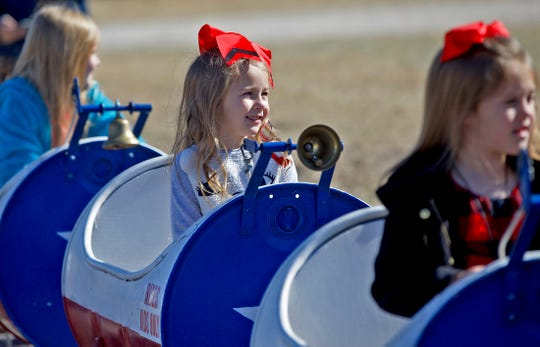 Hadlee Smith, center, prepares to take a kids ride during the Christmas at Old Fort Concho celebration Saturday, Dec. 7, 2019.