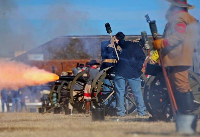 Reenactors set off cannons during the Christmas at Old Fort Concho event Saturday, Dec. 7, 2019.