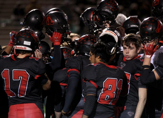 The Strawn football team raise their helmets in salute to their 2019 season after a loss to Richland Springs in the Class 1A Division 2 semifinal game in Abilene on Friday, Dec. 6, 2019.