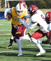 Salisbury University quarterback Jack Lanham stiff arms a defender on Saturday, Dec. 7, 2019 during the NCAA quarterfinal round.