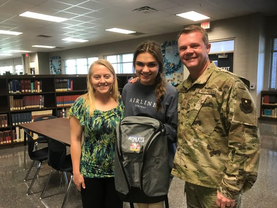 Airline volleyball standout Elizabeth Gatti (center) poses with Airline coaches Reggie Digilormo and Scott Parson and her Times/SBSC Athlete of the Week backpack.