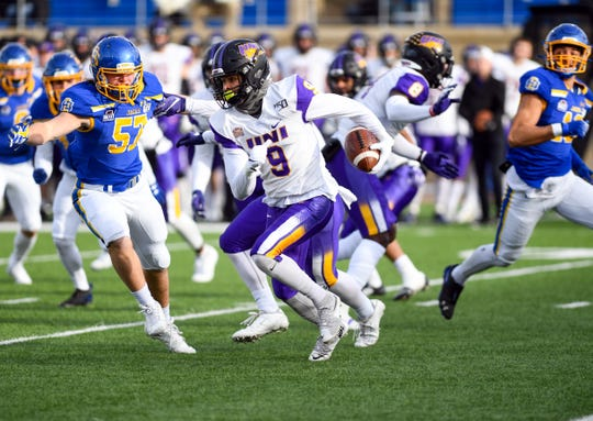 Xavior Williams of the University of Northern Iowa runs the ball during a playoff game on Saturday, Dec. 7, at Dana J. Dykehouse Stadium in Brookings.