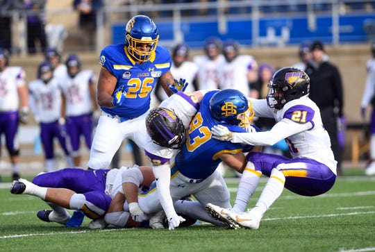 Kallan Hart of SDSU is tackled by University of Northern Iowa players during a playoff game on Saturday, Dec. 7, at Dana J. Dykehouse Stadium in Brookings.