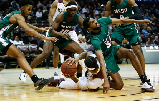 Missouri State senior Tulio Da Silva fights for control of the ball with defenders from Mississippi Valley at JQH Arena on Friday, Dec. 6, 2019.