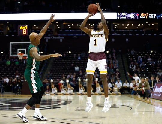 Missouri State senior Keandre Cook shoots a three-pointer over Mississippi Valley State's Caleb Hunter as the Bears take on the Delta Devils at JQH Arena on Friday, Dec. 6, 2019.