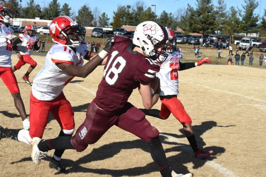 Stuarts Draft's Blake Roach is run out of bounds after a big gain Saturday, Dec. 7, in the Class 2 state semifinals.