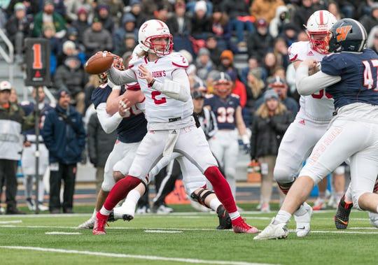 St. John's quarterback Jackson Erdmann makes a pass Saturday against Wheaton in the NCAA Division III quarterfinals at Wheaton, Illinois. The Johnnies won, 34-33.