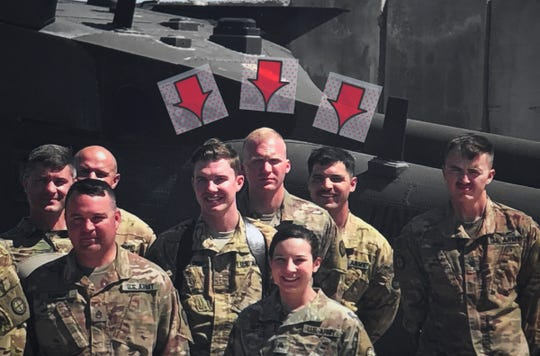 A photo taken in April in Iraq shows James Rogers, Charles Nord and Kort Plantenberg while deployed. The photo was on display during a press conference Saturday, Dec. 7, 2019, at the Army Aviation Support Facility in St. Cloud. The three were killed Thursday when their UH-60 Black Hawk crashed near Marty.