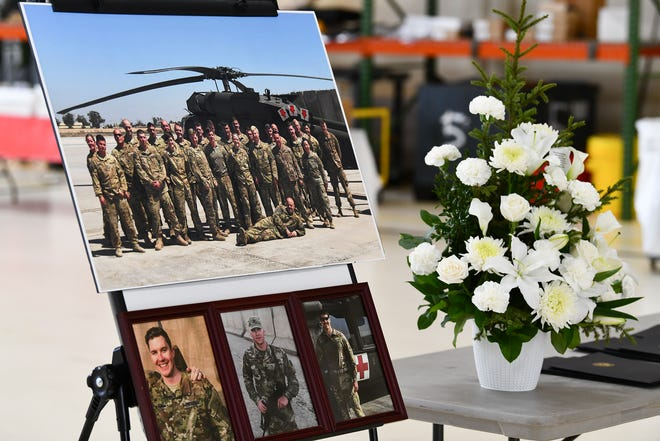 Photos of three soldiers killed in a UH-60 Black Hawk helicopter crash are on display during a press conference Saturday, Dec. 7, 2019, at the Army Aviation Support Facility in St. Cloud.