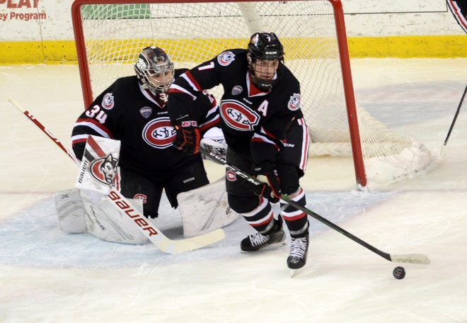 St. Cloud State senior Nick Poehling controls the puck in front of goal in the first period of an NCHC matchup with Miami Friday, Dec. 6, 2019, at Miami University.