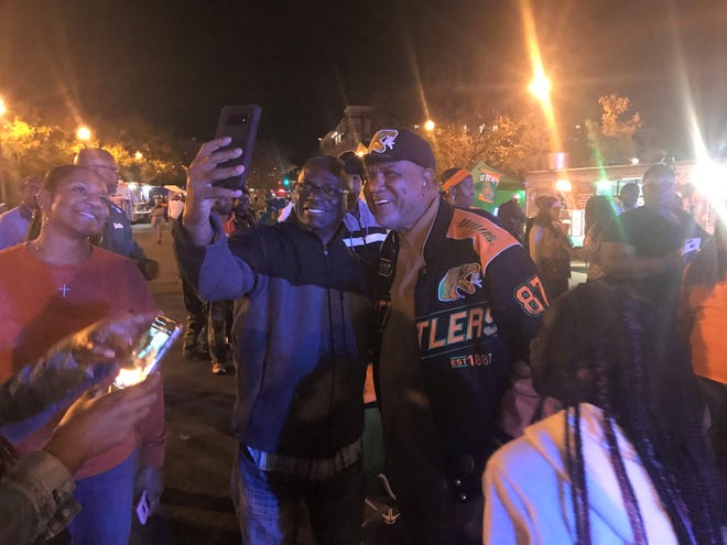 Joe Bullard poses with fans for a selfie at the Frenchtown Rising party on Friday, Dec. 6, 2019.