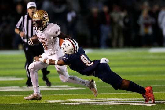 Florida High Seminoles running back Alfred Menjor (6) tries to dodge a tackle. The Florida High Seminoles lost 35-20 to Chaminade-Madonna and finished as Class 3A state runner-up.