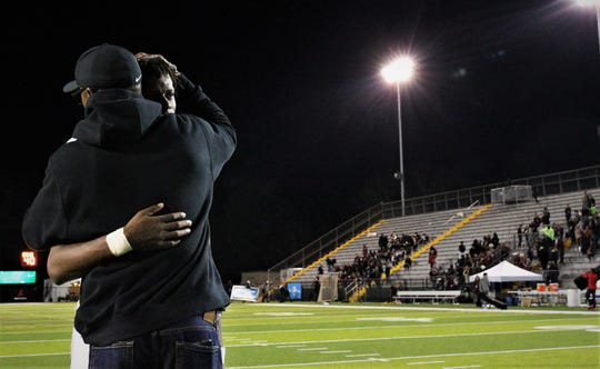 Florida High senior quarterback Willie Taggart Jr. gets a long hug from his dad Willie Taggart Sr. after Florida High's football team fell 35-20 to Chaminade-Madonna in the Class 3A state championship game on Dec. 6, 2019 at Tallahassee's Gene Cox Stadium.