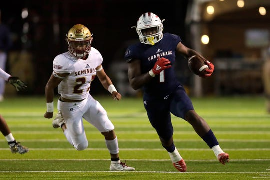 Chaminade-Madonna Lions running back Thaddius Franklin  (1) runs the ball down the field. The Florida High Seminoles lost 35-20 to Chaminade-Madonna and finished as Class 3A state runner-up.