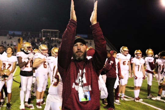 Florida High football coach Jarrod Hickman claps to the crowd after Florida High's football team fell 35-20 to Chaminade-Madonna in the Class 3A state championship game on Dec. 6, 2019 at Tallahassee's Gene Cox Stadium.