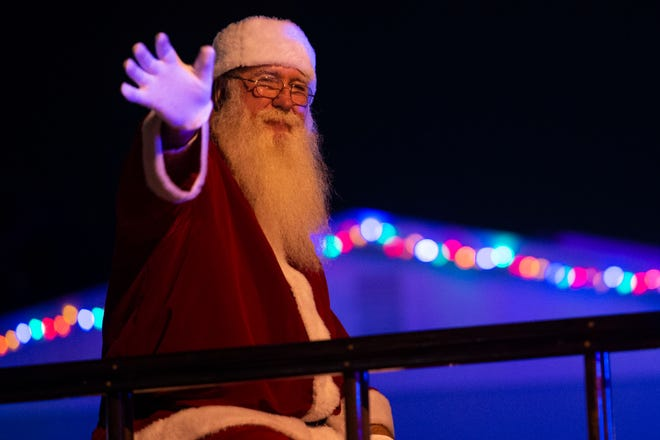 """Thousands lined Southeast Ocean Boulevard to enjoy the 59th annual Stuart Christmas Parade on Friday, Dec. 6, 2019, in Stuart. The theme of this year's parade was """"It's a Green Christmas,"""" with Florida Oceanographic Society executive director Mark Perry serving as the grand marshal."""