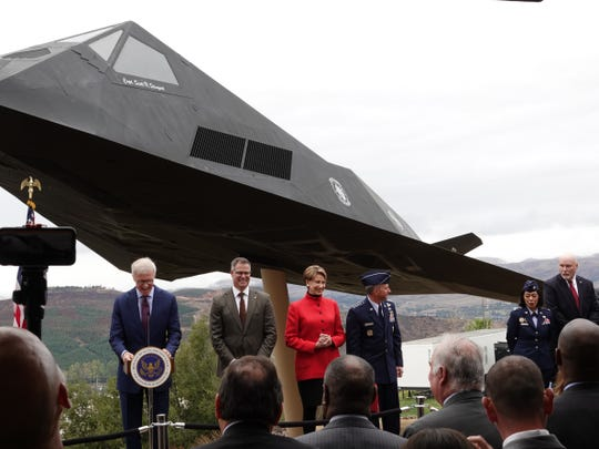 Officials gather to launch the F-117 Nighthawk stealth fighter exhibit Saturday at the Ronald Reagan Presidential Library & Museum.